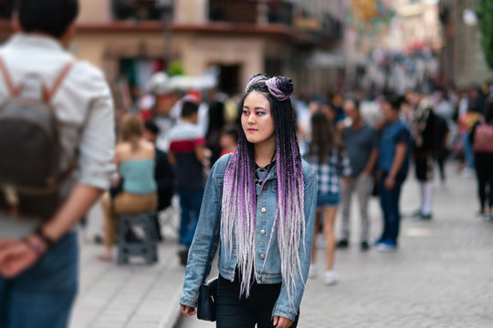 Young woman traveling with a cool hairstyle