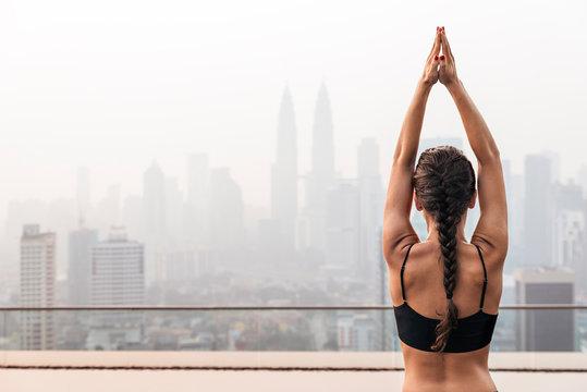 Unrecognizable woman doing yoga exercises