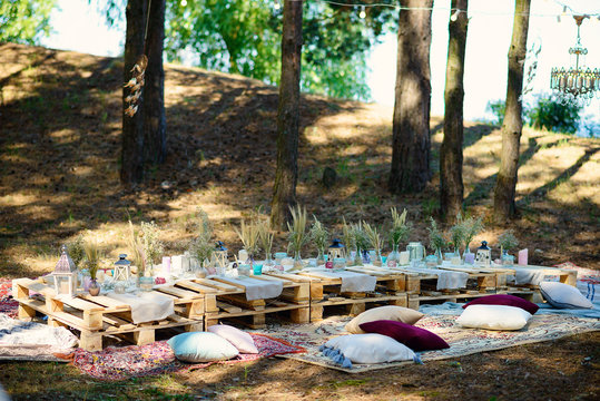 Boho style party decor in the forest. Party decoration for a bachelorette party.