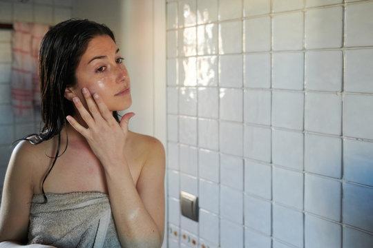 Girl softening skin with cream