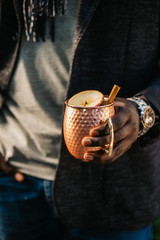 Stylish Man Holding Apple Cider Moscow Mule