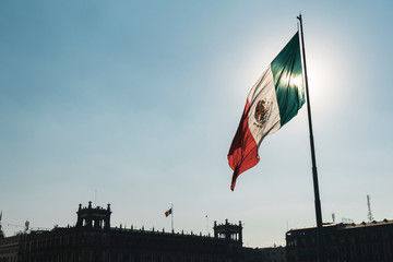 Mexican flag blowing by wind