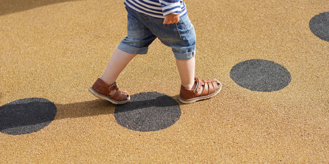 Young child walking alone along path