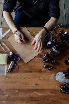 Perfumer writing aroma recipe