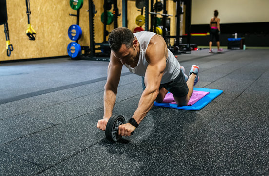 Middle-aged man training in the gym