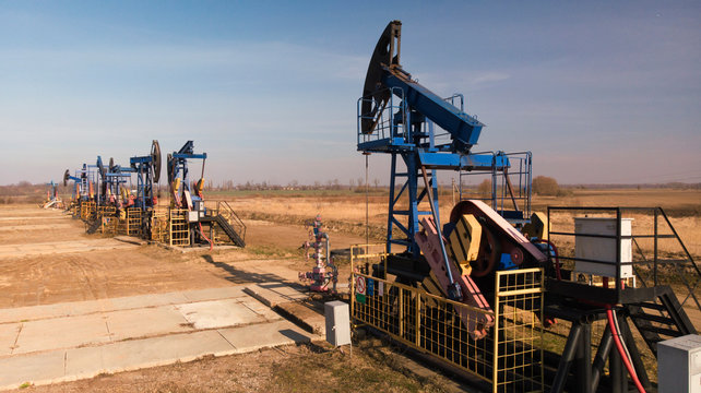 Countryside oil extraction facility in evening