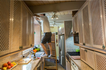 Man doing electrical work in the kitchen