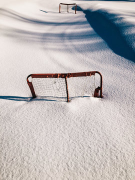 Snow-Covered Hockey Rink With Two Red Goals