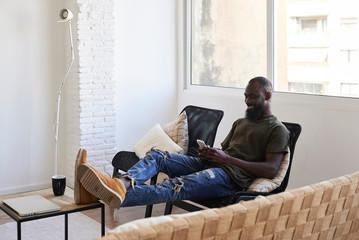 Relaxed black male at home.