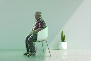 Mature man with bubble wrap sitting on chair indoors