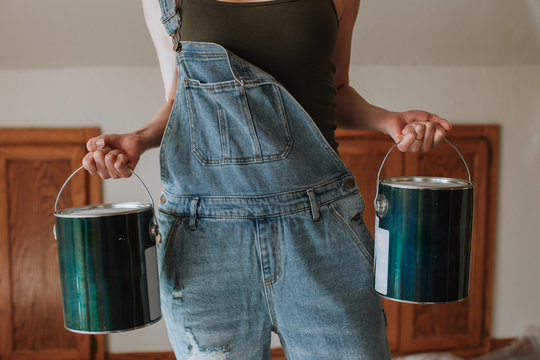 Strong Woman Carrying Paint Cans