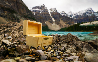 Small Wooden Chest Box Closeup In Epic Mountain Rocky Scene