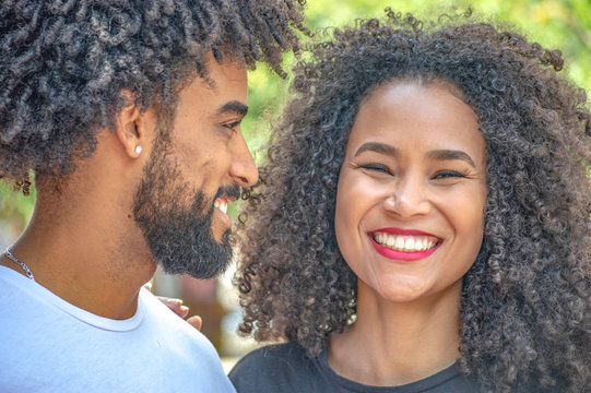 Handsome young black american couple smiling outdoors