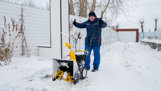 Man Removing Snow. heavy precipitation and snow piles