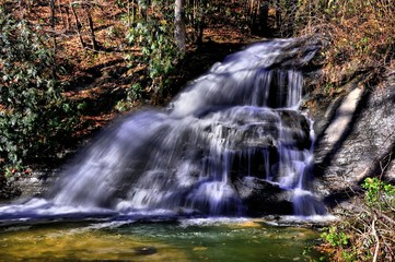 Foto op Aluminium Bos rivier Forest autumn waterfall tending to the bottom