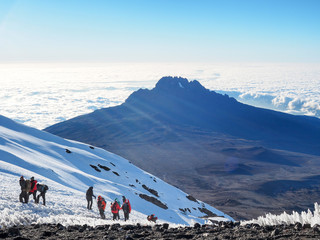 hikers on the ridge ascend mount kilimanjaro the tallest peak in africa. Wall mural