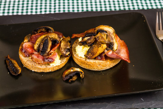 Bacon, egg and mushroom on wholemeal muffins.
