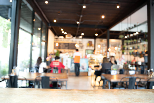 Blurred background barista service customers at counter in coffee shop business concept.