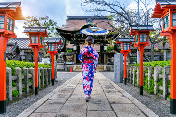 Wall Mural - Asian woman wearing japanese traditional kimono at Kyoto temple in Japan.
