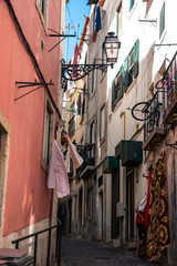 Charming narrow streets in Alfama district, Lisbon, Portugal