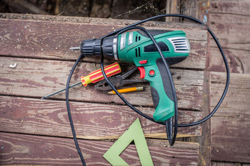 Electric drill and other hand tools on a wooden surface Wall mural