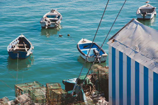 View of fishing boats in Cascais bay. Portugal in autumn