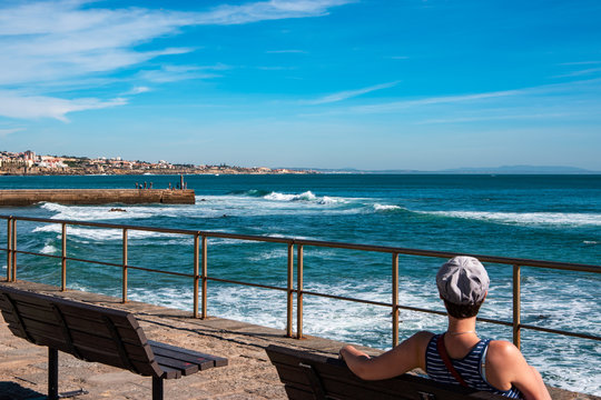 View of Atlantic ocean with a tourist. Cascais-Estoril, Portugal