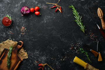 Fotomurales - Old kitchen background with spices and vegetables. Top view. Free copy space.