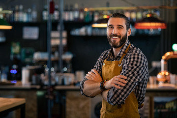 Bartender wearing apron and smiling