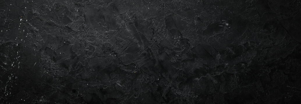 Black stone background. Stone texture. Top view. Free space for your text.