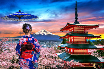 Wall Mural - Cherry blossoms in spring, Asian woman wearing japanese traditional kimono at Chureito pagoda and Fuji mountain at sunset in Japan.
