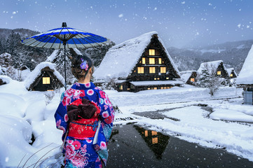 Wall Mural - Asian woman wearing japanese traditional kimono at Shirakawa-go village in winter, UNESCO world heritage sites, Japan.