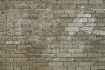 Detailed textured surface of a gray brick wall