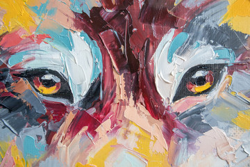 Oil wolf portrait painting in multicolored tones. Conceptual abstract painting of a couple wolves. Closeup of a painting by oil and palette knife on canvas.