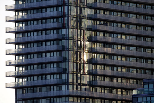 Sunlight reflects from the windows of condominiums in Toronto