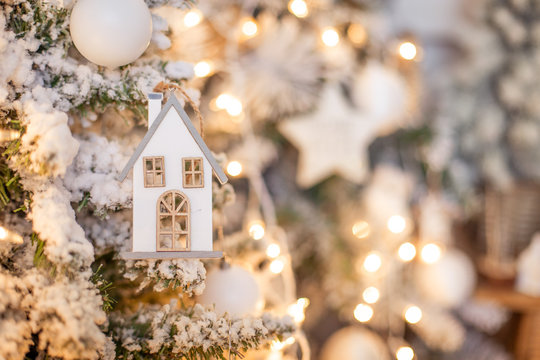Family budget annuity mortgage savings housing purchase realtor deal. needle in the form of a house on a Christmas tree. New Year background texture place for text