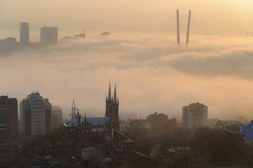 Wall Mural - Vladivostok cityscape daylight view. Fog over the city.