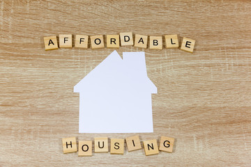 The words 'Affordable Housing' wth a paper house shape