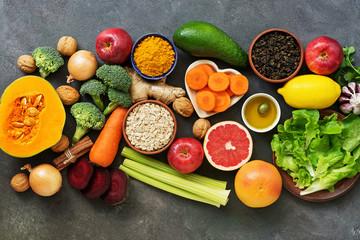 Liver detox diet food concept, fruits, vegetables, nuts, olive oil, garlic. Cleansing the body,...