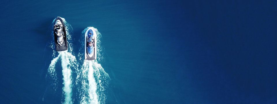 Aerial drone top view of jet skis cruising in deep blue sea