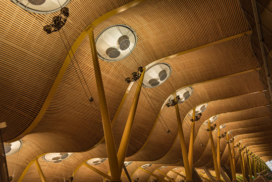 Madrid, Spain Sept 01, 2019: Wooden Terminal in Madrid's Barajas airport. Incredible curved wooden ceiling in Madrid's airport in Spain