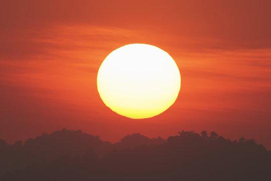 Big sun with sunset time.