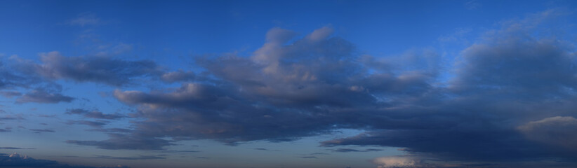 Evening cloudy sky. Autumn atmospheric phenomenon, panoramic photography, mid-September. Fotobehang