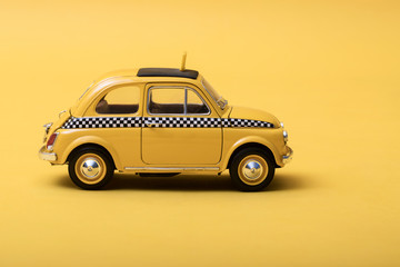 Recess Fitting Vintage cars Yellow retro toy taxi on yellow background