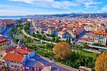 Foto op Canvas Nice Colorful aerial panoramic view over the old town of Nice, France, with the famous Massena square and the Promenade du Paillon, from the roof of Saint Francis tower