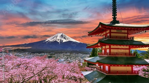 Wall mural Time lapse of Cherry blossoms in spring, Chureito pagoda and Fuji mountain at sunset in Japan.