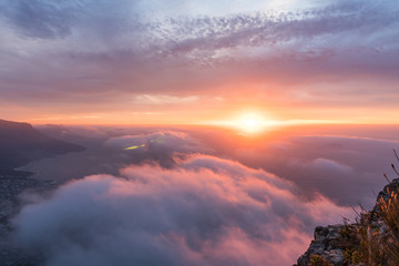 Beautiful sunset above the clouds on Lions Head in Cape Town South Africa with the sea in the background Wall mural