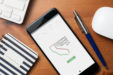 CCPA concept: smartphone with an imaginary page showing a link to read the California consumer privacy act which will come into force in January 2020