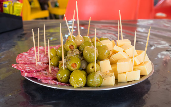 Puerto Iguazu, Argentina - Circa October 2019: A plate of picada (typical appetizer made of a variety of cheeses and cold cuts) at La Feirinha in Puerto Iguazu, famous local market