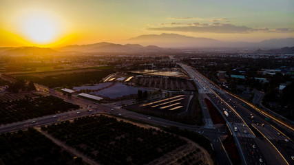 The freeway during sunset with mountains in the background in RIverside, California, USA